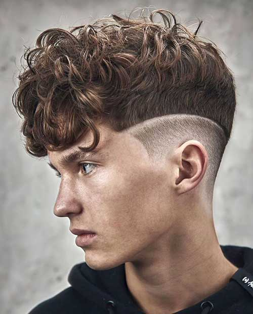 curly medium fade with hard part line