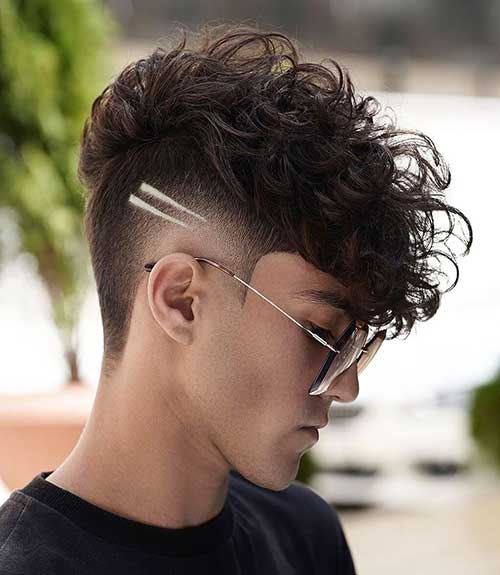 fringe mid fade with design curly hairstyle