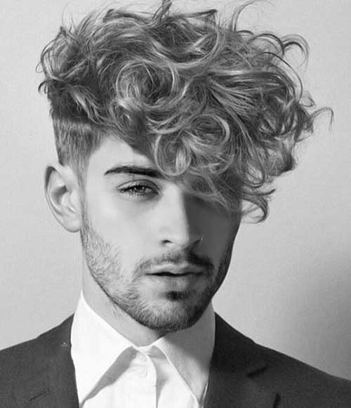 long messy short sides curly hairstyle