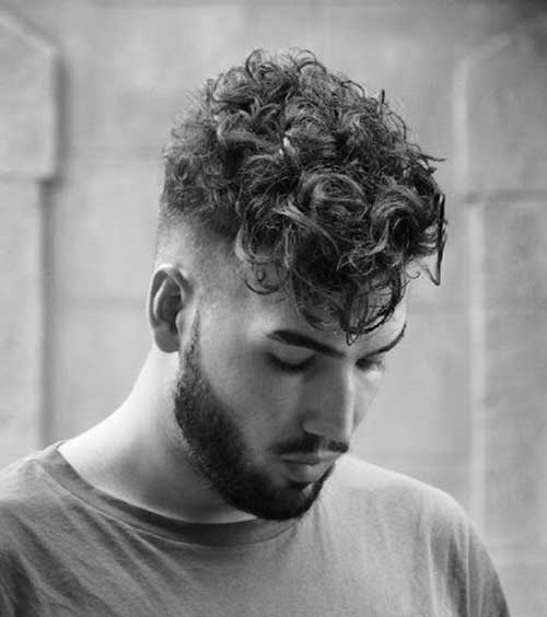 messy low fade curly hairstyle