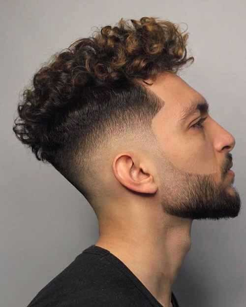 taper fade curly hairstyles for men 1