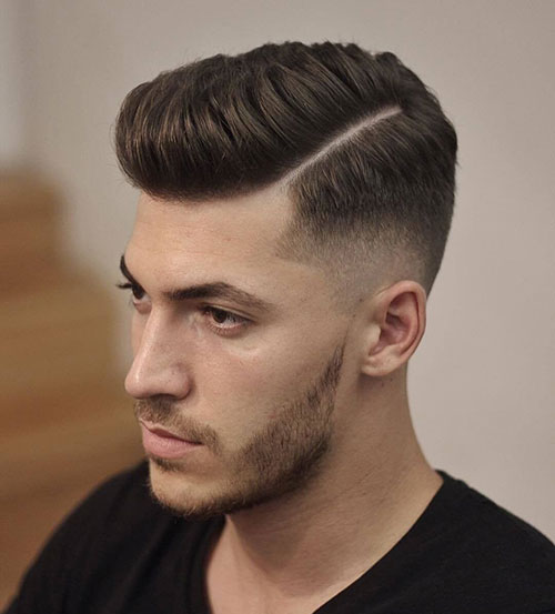 comb over low fade with hard part 532