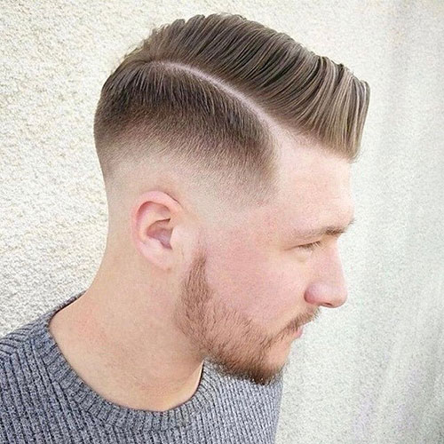 comb over low fade with hard part 535